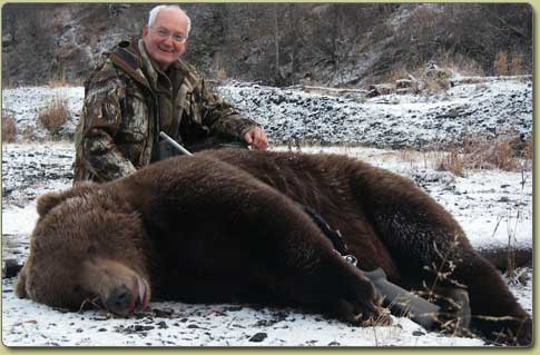 Hunter wih large Kodiak Bear